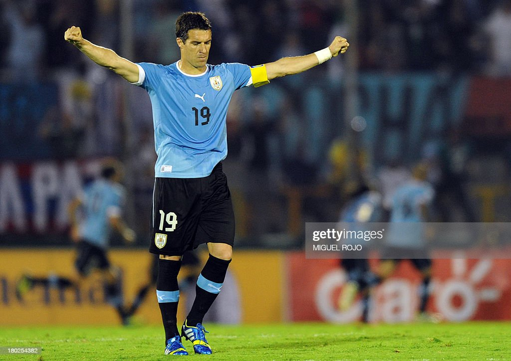 Uruguayan defender Andres Scotti celebrates a goal against Colombia during their Brazil 2014 FIFA World Cup South American qualifier match in...