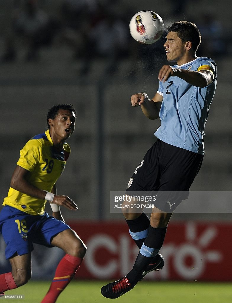 Uruguayan defender Emiliano Velazquez (R) heads the ball past Ecuadorean midfielder Andres Ona during their South American U-20 Championship Group B football match, at Bicentenario stadium in San Juan, Argentina, on January 14, 2013. Four South American teams will qualify for the FIFA U-20 World Cup Turkey 2013. The match ended in a 2-2 draw.