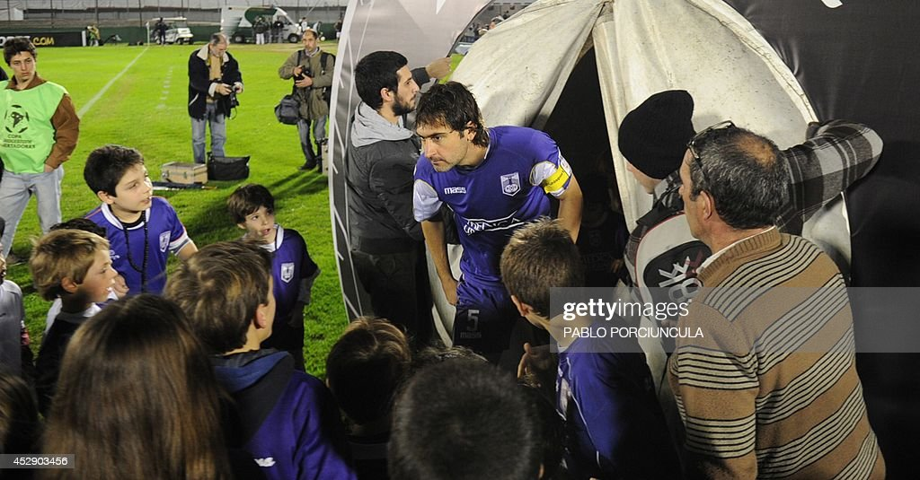 Uruguayan Defensor's Jose Fleurquin enters the field before the Copa Libertadores semifinal second leg football match against Paraguay's Nacional, at Centenario Stadium in Montevideo on July 29, 2014.