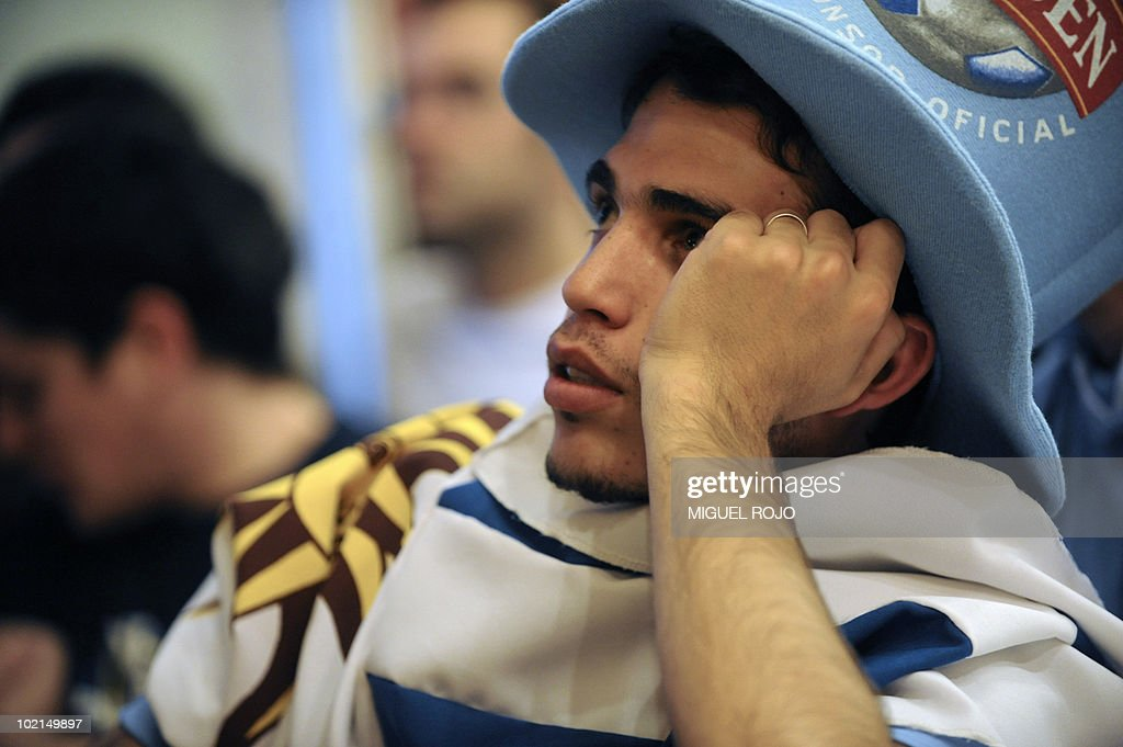 A Uruguayan football fan gestures as he watches the FIFA World Cup 2010 Uruguay vs South Africa football match in a bar in downtown Montevideo, on June 16, 2010. AFP PHOTO/Miguel ROJO