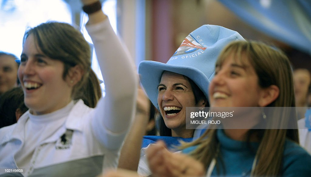 Uruguayan football fans celebrate as they watch the FIFA World Cup 2010 Uruguay vs South Africa football match in a bar in downtown Montevideo, on June 16, 2010. AFP PHOTO/Miguel ROJO