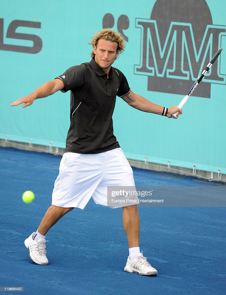 Football player Diego Forlan Plays Tennis at la Caja Magica s