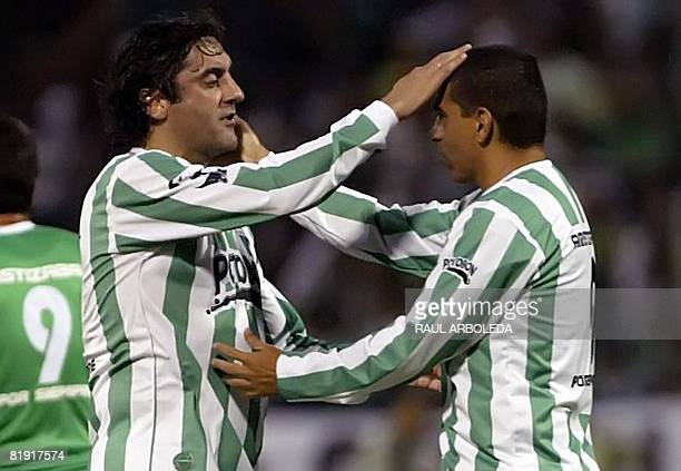 Uruguayan footballer Enzo Francescoli greets Colombian footballer Victor Hugo Aristizabal during the latter's farewell match on July 12 at the...