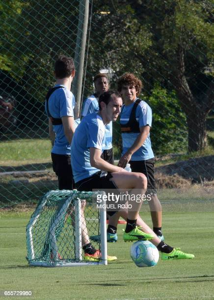 Uruguayan footballers Diego Godin and Matias Corujo take part in a training session ahead of their FIFA World Cup South American qualifier football...