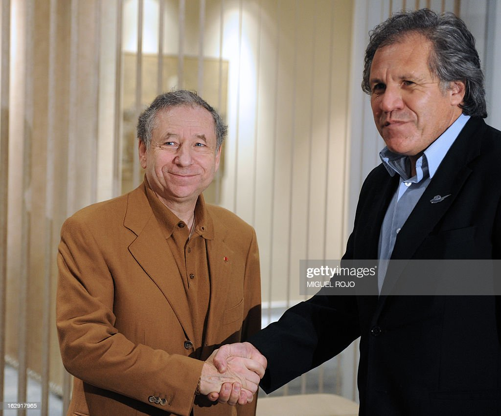 Uruguayan Foreign Minister Luis Almagro (R), shakes hand with F.I.A president Jean Todt in Montevideo on March 1, 2013. Todt is in Uruguay to attend the arrival of the '19 Capitals' rally. AFP PHOTO/Miguel ROJO