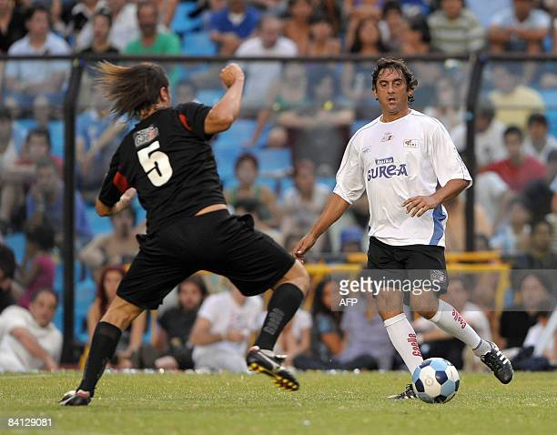 Uruguayan former footballer Enzo Francescoli vies for the ball with Argentine former footballer Fernando Redondo during the friendly match called 'To...
