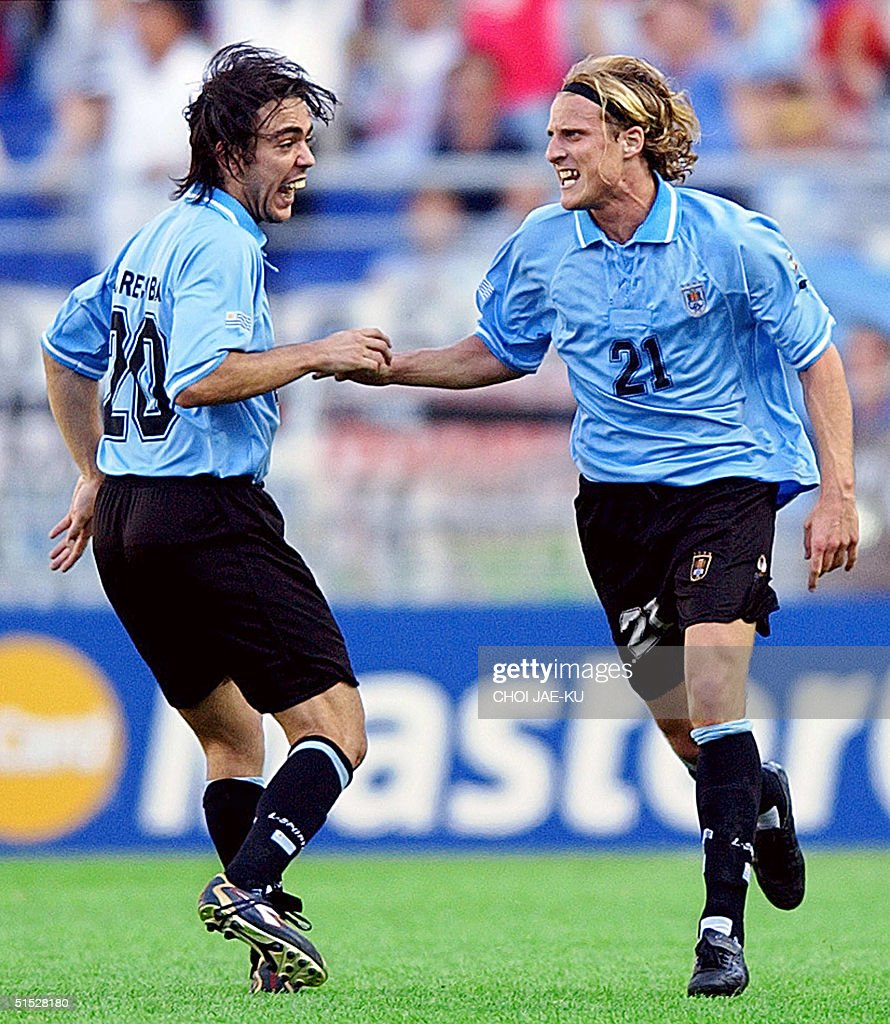 Uruguayan forward Diego Forlan R is congratulate
