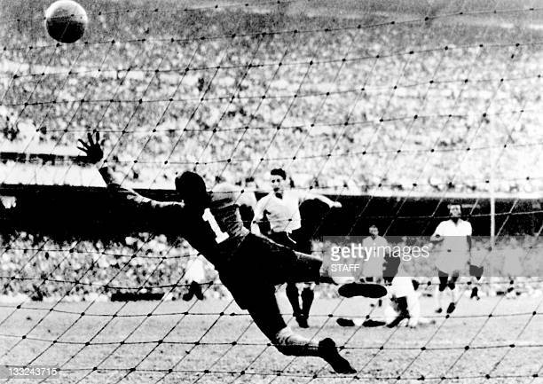 Uruguayan forward Juan Alberto Schiaffino kicks the ball past Brazilian goalkeeper Moacyr Barbosa to tie the score at 1 during the World Cup final...