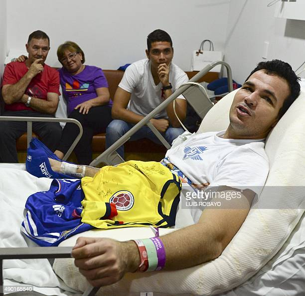 Uruguayan goalkeeper Alexis Viera of Colombia's Depor FC team is seen during an interview with AFP accompanied by relatives at his room at the Valle...