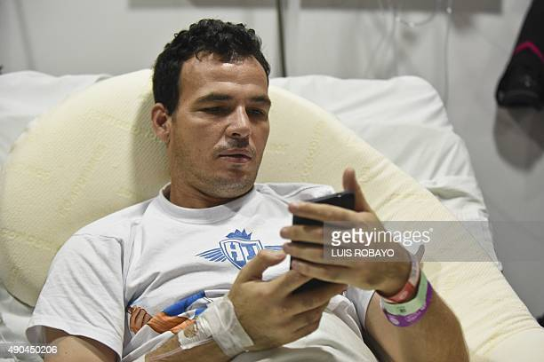 Uruguayan goalkeeper Alexis Viera of Colombia's Depor FC team is seen during an interview with AFP at his room at the Valle del Lili clinic on...