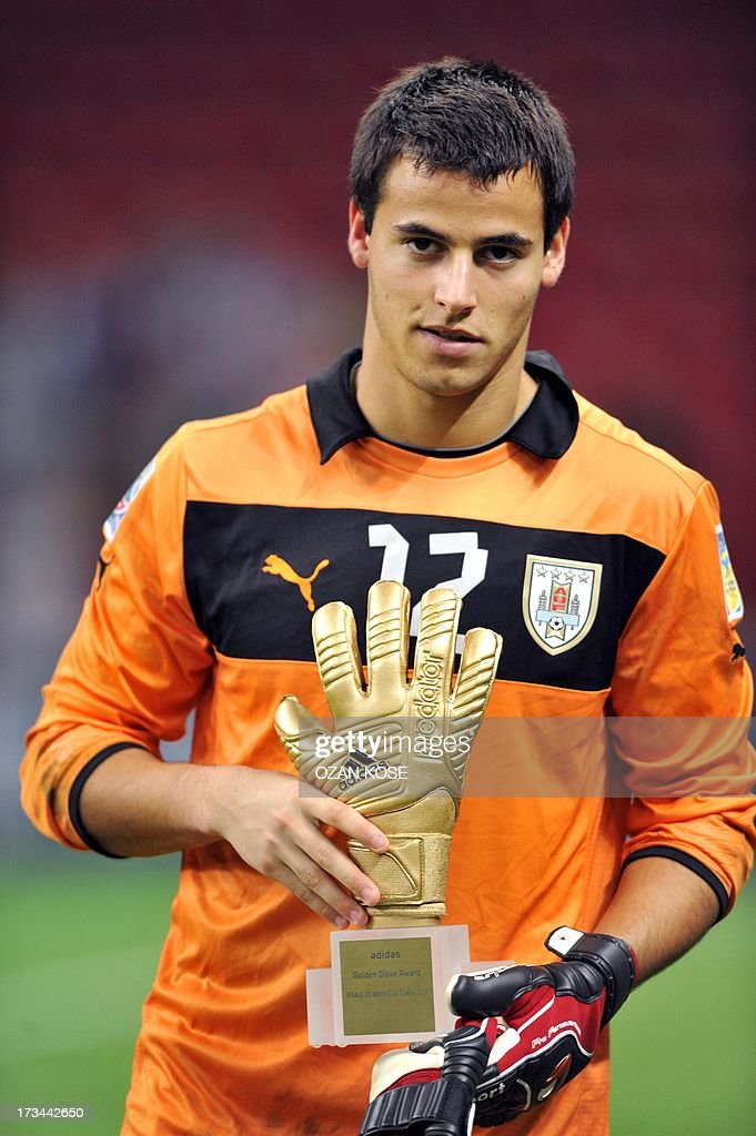 Uruguayan goalkeeper Guillermo De Amores poses with the Golden Golve award after the FIFA Under 20 World Cup final football match between France and Uruguay at Turk Telecom Stadium in Istanbul on July 13, 2013.