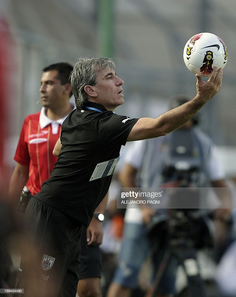 Uruguayan head coach Juan Verzeri takes a ball during the South American U-20 Championship Group B football match against Brazil, at Bicentenario stadium in San Juan, Argentina, on January 12, 2013. Four South American teams will qualify for the FIFA U-20 World Cup Turkey 2013. Uruguay won 3-2.