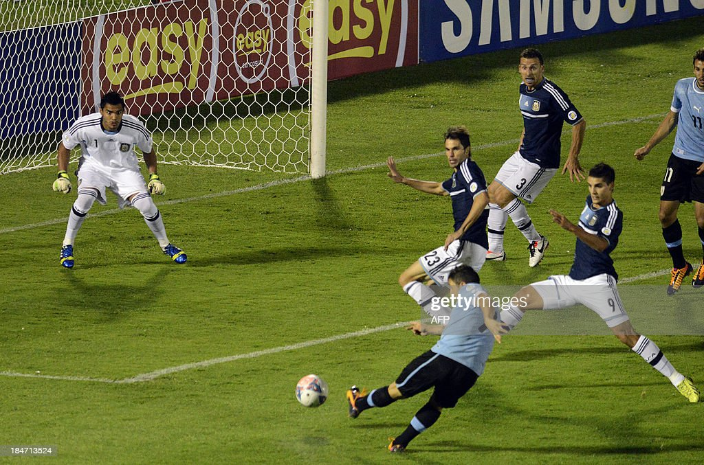 Uruguayan midfielder Cristian Rodriguez shoots to score against Argentina during their Brazil 2014 FIFA World Cup South American qualifier match in...