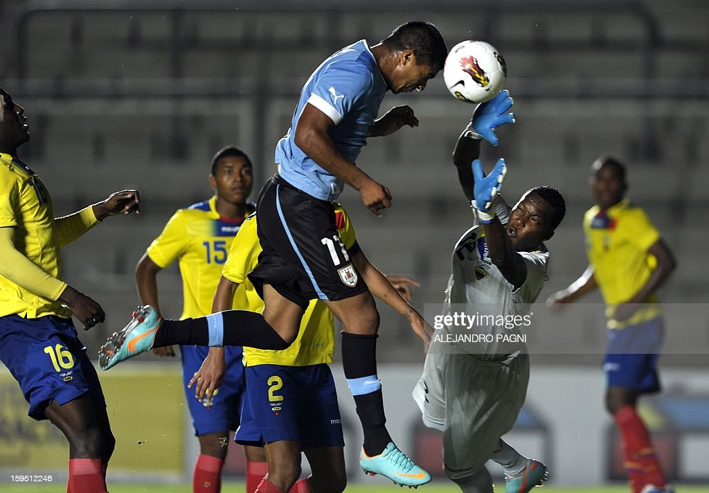 Uruguayan midfielder Rodrigo Aguirre (C) heads the ball to score the team's second goal against Ecuador during their South American U-20 Championship Group B football match, at Bicentenario stadium in San Juan, on January 14, 2013. Four South American teams will qualify for the FIFA U-20 World Cup Turkey 2013.