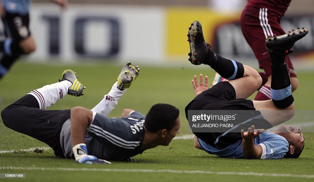 Uruguayan midfielder Sebastian Cristoforo (R) and Venezuelan goalkeeper Jose Contreras fall on the ground during their South American U-20 Group B football match at Bicentenario stadium in San Juan, Argentina, on January 18, 2013. Four teams will qualify for the Turkey 2013 FIFA U-20 World Cup.
