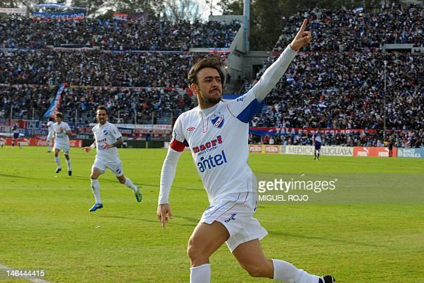Uruguayan Nacional's Alvaro Recoba celebrates after scoring a goal against Defensor in their Uruguayan Championship football final match on June 16...