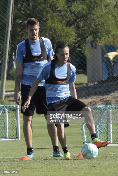 Uruguayan national team footballers Diego Laxalt and Sebastian Coates take part in a training session ahead of their FIFA World Cup South American...