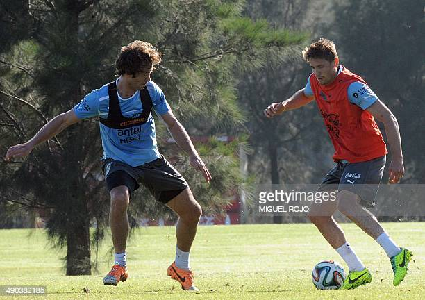 Uruguayan national team footballers Diego Lugano and Gaston Ramirez take part in a training session on May 14 at the Complejo Celeste training center...
