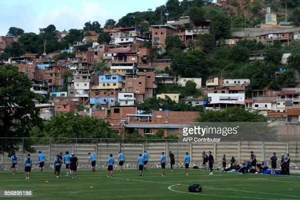 Uruguayan national team footballers jog during a training session at the Puerto Azul Club field in La Guaira Venezuela on October 2 2017 ahead of...