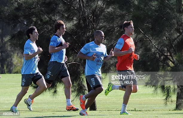 Uruguayan national team footballers Jorge Fucile Diego Lugano Arevalo Rios and Gaston Ramirez take part in a training session on May 14 at the...