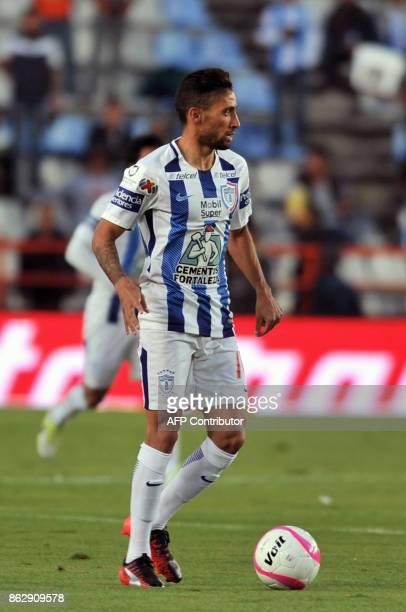 Uruguayan player Jonathan Urretaviscaya of Pachuca controls the ball during their Mexican Apertura tournament football match against Toluca at the...