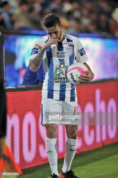 Uruguayan player Jonathan Urretaviscaya of Pachuca prepares to throw in during their Mexican Apertura tournament football match against Toluca at the...