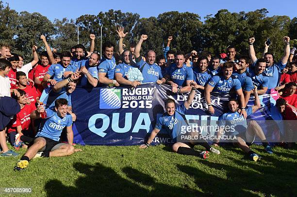 Uruguayan players celebrate after defeating Russia and qualifying for Rugby World Cup 2015 at Charrua stadium in Montevideo on October 11 2014 AFP...
