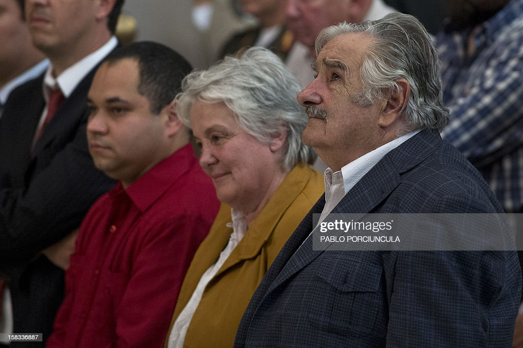 Uruguayan President Jose Mujica (R) his wife, senator Lucia Topolansky and Venezuelan ambassador to Uruguay, Julio Ramon Chirino (L) take part in a mass for the health of Venezuelan President Hugo Chavez, on December 13, 2012 in Montevideo. Chavez experienced 'complications,' including bleeding, during his cancer surgery but was showing positive signs of recovery on Thursday, a senior aide said. AFP PHOTO/Pablo PORCIUNCULA