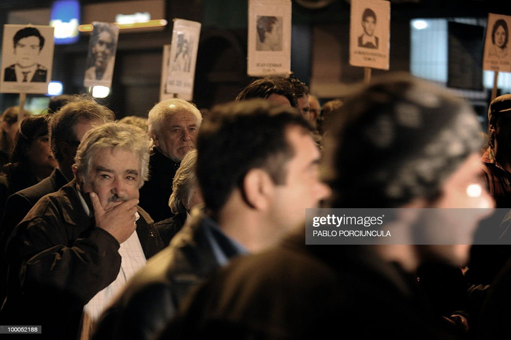 Uruguayan President Jose Mujica (L) marches with relatives of people disappeared during the country's last dictatorship (1973-84), during the annual 'March od Silence' in Montevideo, on May 20, 2010. AFP PHOTO/Pablo PORCIUNCULA