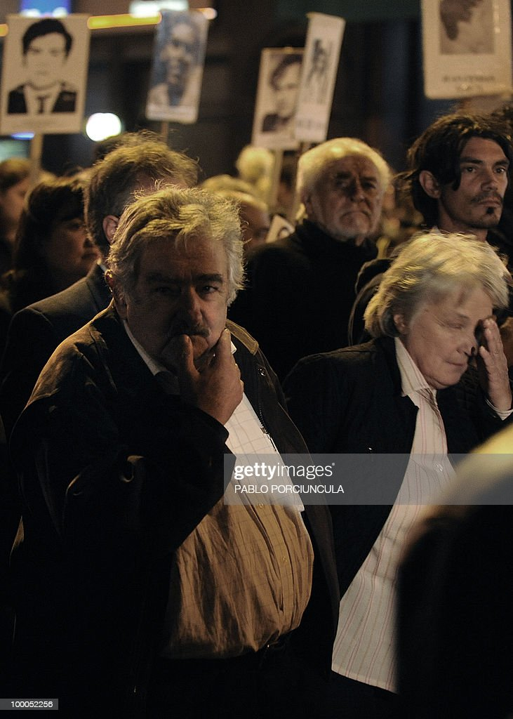 Uruguayan President Jose Mujica (L) marchs with relatives of people disappeared during the country's last dictatorship (1973-84) in the annual 'March of Silence' in Montevideo on May 20, 2010. AFP PHOTO/Pablo PORCIUNCULA