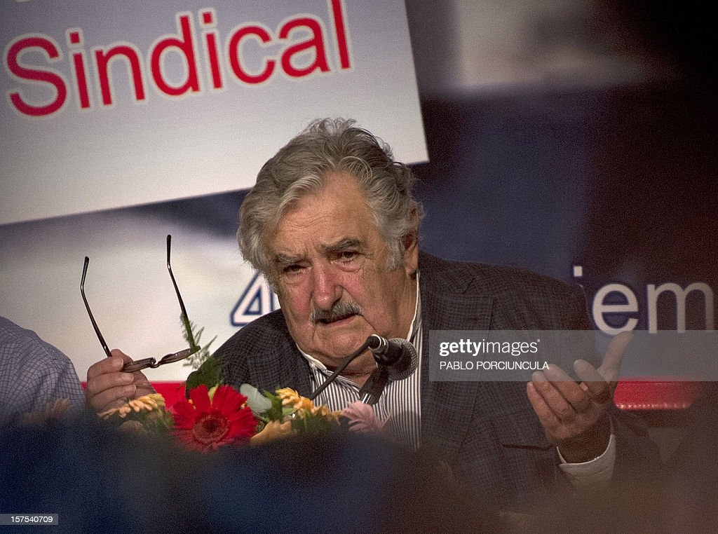 Uruguayan President Jose Mujica speaks during a working breakfast at the headquarters of the PIT-CNT Uruguayan labor union federation in Montevideo on December 4, 2012. AFP PHOTO/Pablo PORCIUNCULA