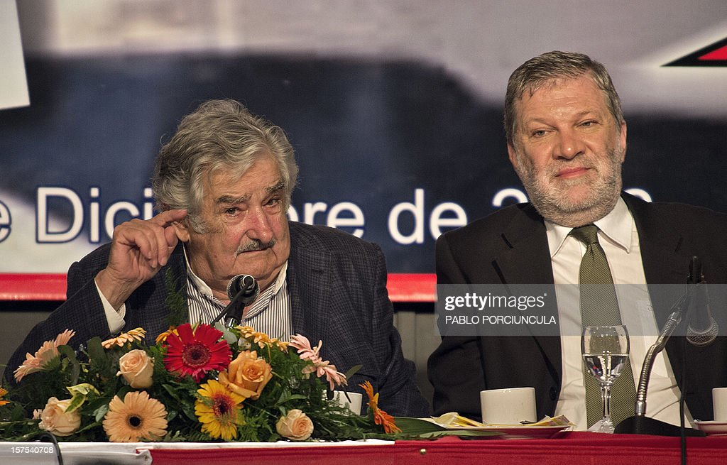 Uruguayan President Jose Mujica (L) speaks next to his Minister of Industry, Energy and Mines, Roberto Kreimerman, during a working breakfast at the headquarters of the PIT-CNT Uruguayan labor union federation in Montevideo on December 4, 2012. AFP PHOTO/Pablo PORCIUNCULA
