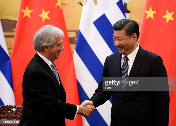 Uruguayan President Tabare Vazquez shakes hands with Chinese President Xi Jinping during a signing ceremony at the Great Hall of the People on...