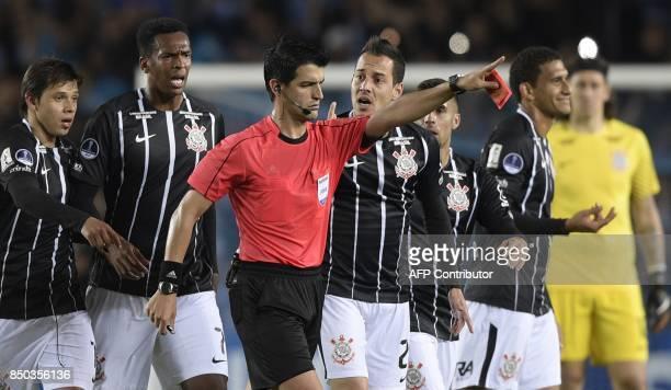 Uruguayan referee Leodan Gonzalez shows the red card to and sends off Brazil's Corinthians midfielder Rodriguinho during their Copa Sudamericana...