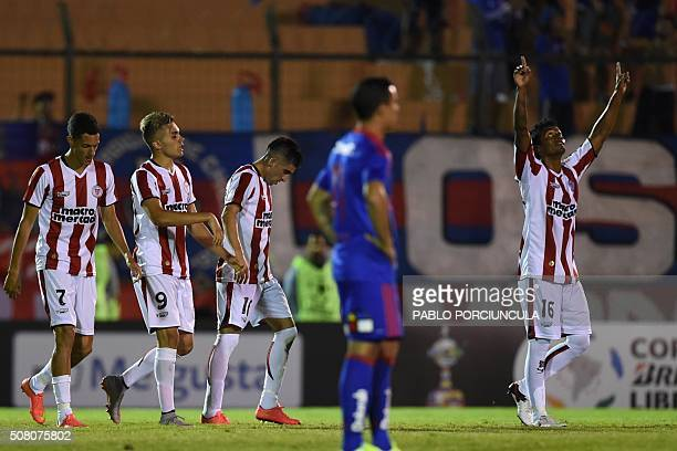 Uruguayan River Plate's Cesar Tajan celebrates his goal against Chilean Universidad de Chile during a Copa Libertadores 2016 football match at...