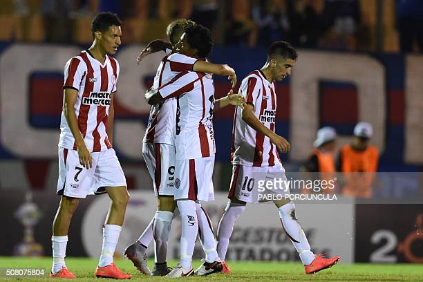 Uruguayan River Plate's Cesar Tajan celebrates with teammates his goal against Chilean Universidad de Chile during a Copa Libertadores 2016 football...