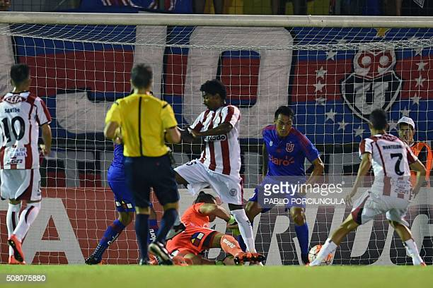 Uruguayan River Plate's Cesar Tajan kicks to score against Chilean Universidad de Chile during a Copa Libertadores 2016 football match at Domingo...
