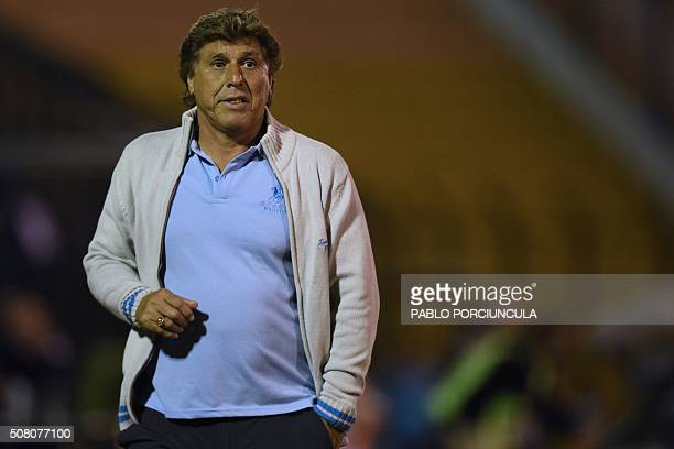 Uruguayan River Plate's coach Juan Ramon Carrasco looks on during the Copa Libertadores 2016 football match against Universidad de Chile at Domingo...