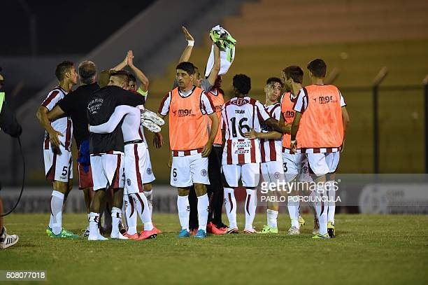 Uruguayan River Plate's footballers celebrate after defeating Chilean Universidad de Chile in a Copa Libertadores 2016 football match at Domingo...