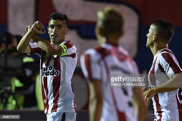 Uruguayan River Plate's forward Michael Santos celebrates his goal against Chilean Universidad de Chile during a Copa Libertadores 2016 football...