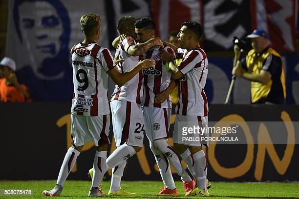 Uruguayan River Plate's forward Michael Santos celebrates with teammates his goal against Chilean Universidad de Chile during a Copa Libertadores...