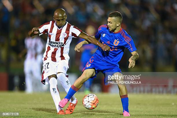 Uruguayan River Plate's midfielder Angel Rodriguez vies for the ball with Chilean Universidad de Chile's midfielder Luis Farina during a Copa...