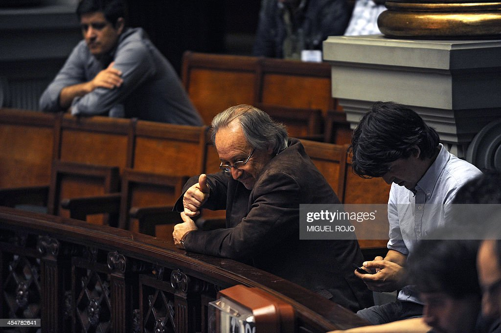 Uruguayan Secretary General of the National Drugs Committee, Julio Calzada, gives the thumb up at the Parliament building in Montevideo on December 10, 2013, during the discussion of a law on the legalization of marijuana's cultivation and consumption. Uruguays parliament is to vote Tuesday a project that would make the country the first to legalize marijuana, an experiment that seeks to confront drug trafficking. The initiative launched by 78-year-old Uruguayan President Jose Mujica, a former revolutionary leader, would enable the production, distribution and sale of cannabis, self-cultivation and consumer clubs, all under state control. AFP PHOTO/ Miguel Rojo