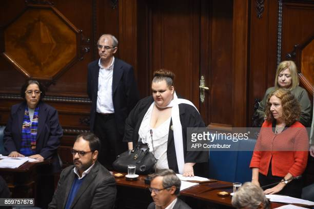 Uruguayan senator Michelle Suarez arrives at the senate for her swear in ceremony in Montevideo on October 10 2017 Michelle Suarez is the first...