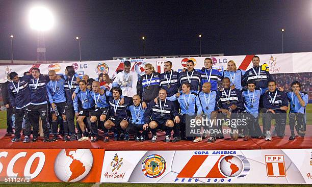 Uruguayan soccer team pose for the picture with their third place medals after defeating Colombia in the Copa America 24 July 2004 at the Garcilaso...