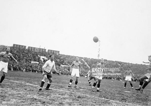 Uruguayan striker Pedro Cea is outnumbered by Yugoslavian defenders during the FIFA World Cup SemiFinal at the Estadio Centenario in Montevideo 27th...
