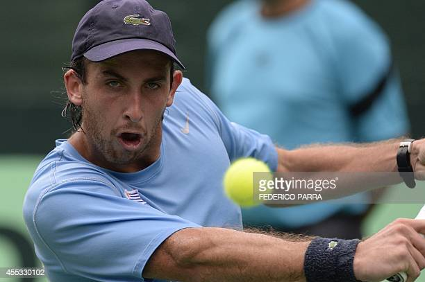 Uruguayan tennis player Martin Cuevas hits a return to Venezuelan Ricardo Rodríguez during their Davis Cup American Zone Group I singles match in...