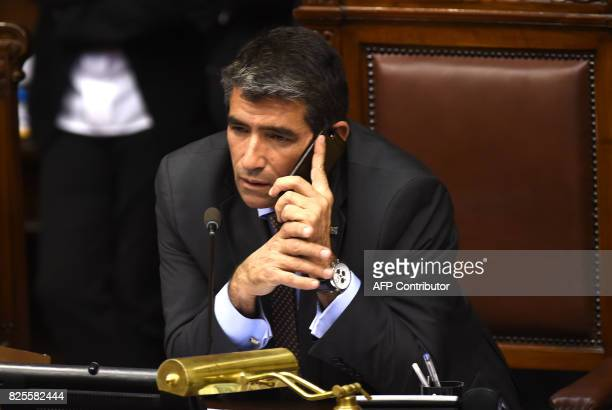Uruguayan Vice President Raul Sendic uses his phone as he chairs the General Assembly at the Legislative Palace in Montevideo on August 1 2017 ROJO