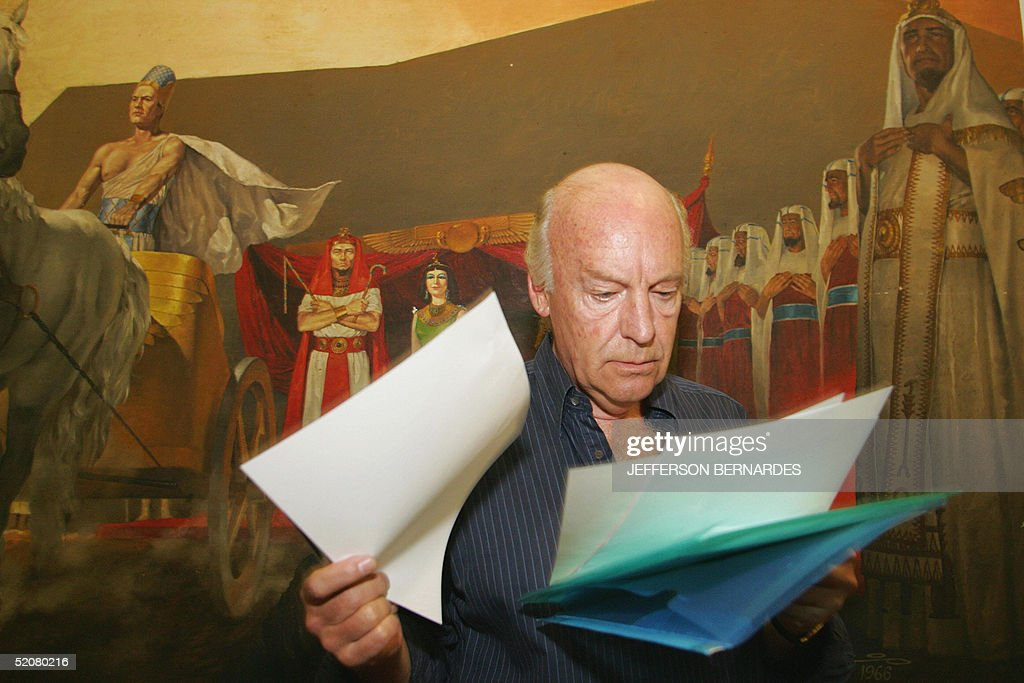 Uruguayan writer <a gi-track='captionPersonalityLinkClicked' href=/galleries/search?phrase=Eduardo+Galeano&family=editorial&specificpeople=2578757 ng-click='$event.stopPropagation()'>Eduardo Galeano</a> leafs through some notes before delivering his speech at the V World Social Forum 29 January, 2005 in Porto Alegre, southern Brazil. Anti-globalization activists gathering at the WSF decried Friday the plight of 27 million people working in slave-like conditions across the world, while Iraq war opponents also made their voices heard during the annual meeting.