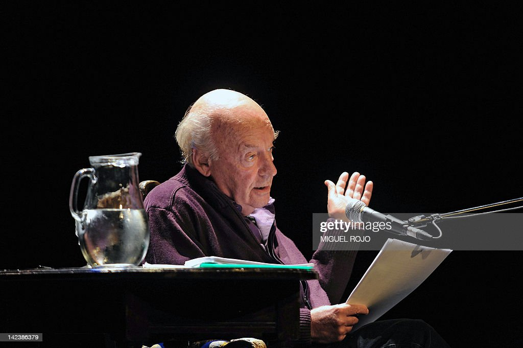 Uruguayan writer <a gi-track='captionPersonalityLinkClicked' href=/galleries/search?phrase=Eduardo+Galeano&family=editorial&specificpeople=2578757 ng-click='$event.stopPropagation()'>Eduardo Galeano</a> reads from his new book 'Los hijos de los dias' (The sons of the days) at the Solis Theater in Montevideo on April 3, 2012. AFP PHOTO/Miguel ROJO